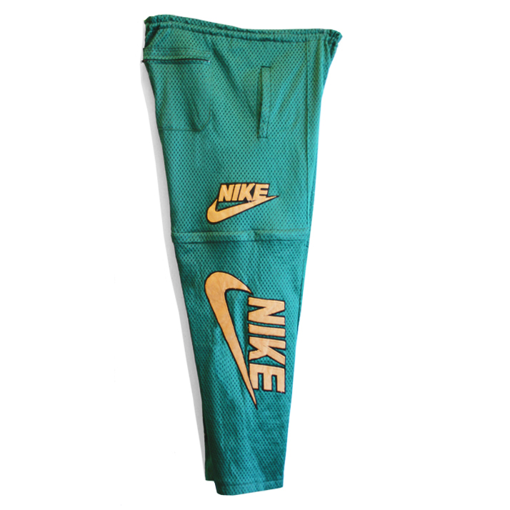 dea0f1d9ec Notes  Deadstock   Archived Design Piece   Rifle Green Pantone Color Scheme    Mesh Construction   Stitched Iconic Khaki Nike Logo at Both Sides of Pant  ...